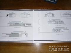 建築模型を手渡し